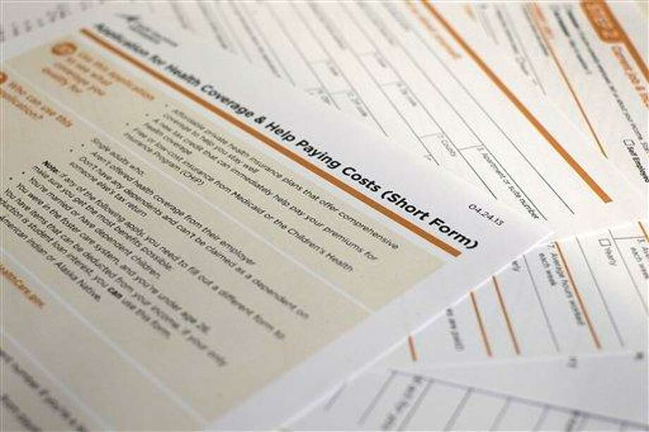 This application obtained by The Associated Press shows the short form for the new federal Affordable Care Act. The first draft was as mind-numbing as a tax form. Tuesday the Obama administration unveiled simplified application forms for health insurance benefits under the federal health care overhaul. The biggest change: a five-page short form that single people can fill out. That total includes a cover page with instructions, and an extra page to fill out if you want to designate someone to help you through the process. (AP Photo/J. David Ake) Photo: AP / AP