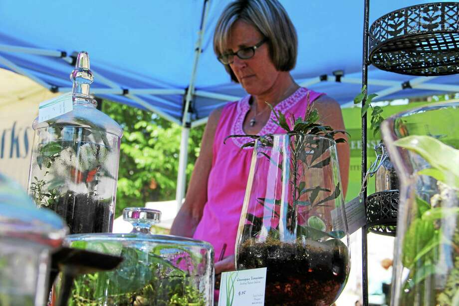 Janet Jochem with some of her work at the Gallery on the Green in Litchfield Saturday. Photo: Isaac Avilucea — REGISTER CITIZEN