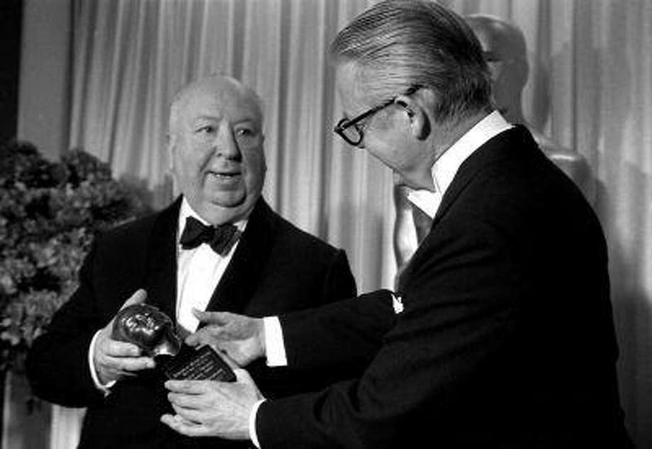 Robert Wise, right, presents the Irving G. Thalberg memorial Award for consistent production to Alfred Hitchcock, in Santa Monica, Calif. April 11,1968. Presentation came during the annual ceremonies by the Academy of Motion Picture Arts and Sciences.(AP Photo) Photo: ASSOCIATED PRESS / AP1968