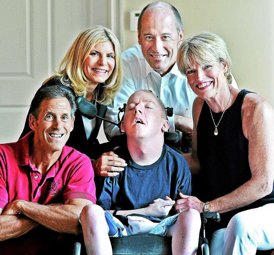 (Peter Casolino — New Haven Register)   The Kelley family and friends founded Brian's Hope, an ALD awareness organization after Brian, center. He is shown with his father, Dr. Jack Kelley (rear), his mother Jean Kelley (right), Linda Kowalski and her husband Mark Gilhuly. They are shown at the Kelley home in Branford. Photo: Journal Register Co.