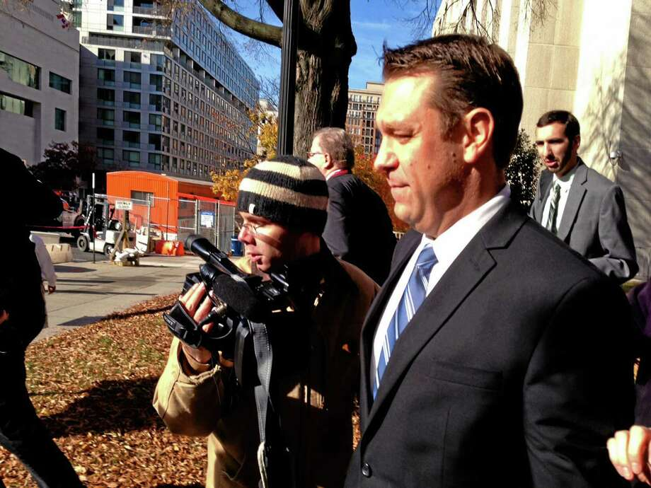 """This photo taken with a cellphone shows Rep. Henry """"Trey"""" Radel, R-Fla. leaving court in Washington, Wednesday, Nov. 20, 2013, leaving court after pleading guilty to a misdemeanor charge of cocaine possession and was sentenced to a year's probation. (AP Photo/Jessica Gresko) Photo: AP / AP"""