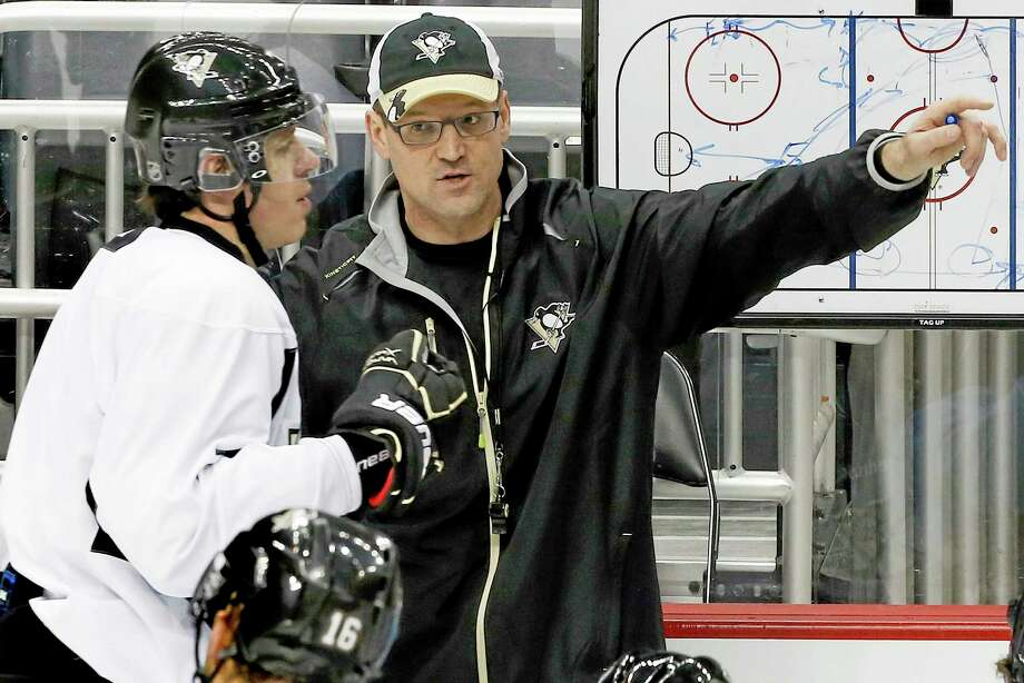 In this Jan. 14, 2013 file photo, Pittsburgh Penguins head coach Dan Bylsma, right, explains a drill to Evgeni Malkin during practice at the Consol Energy Center in Pittsburgh. Photo: Gene J. Puskar — The Associated Press File Photo  / AP