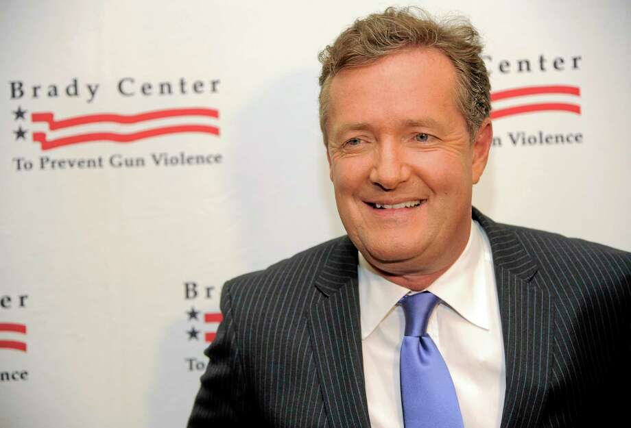 """FILE - In this May 7, 2013, file photo, honoree Piers Morgan poses at the Brady Campaign to Prevent Gun Violence Los Angeles Gala at The Beverly Hills Hotel in Beverly Hills, Calif. CNN said Sunday, Feb. 23, 2014, that the prime-time talk show """"Piers Morgan Live"""" is coming to an end and that the show's final airdate has yet to be determined. (Photo by Chris Pizzello/Invision/AP, File) Photo: Chris Pizzello/Invision/AP / Invision"""