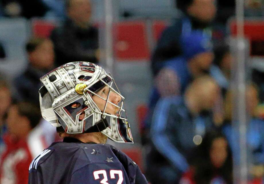 Team USA goaltender Jonathan Quick of Hamden checks the scoreboard during the second period of Finland's 5-0 win in the men's hockey bronze-medal game on Saturday at the Winter Olympics in Sochi, Russia. Photo: Mark Humphrey — The Associated Press  / AP