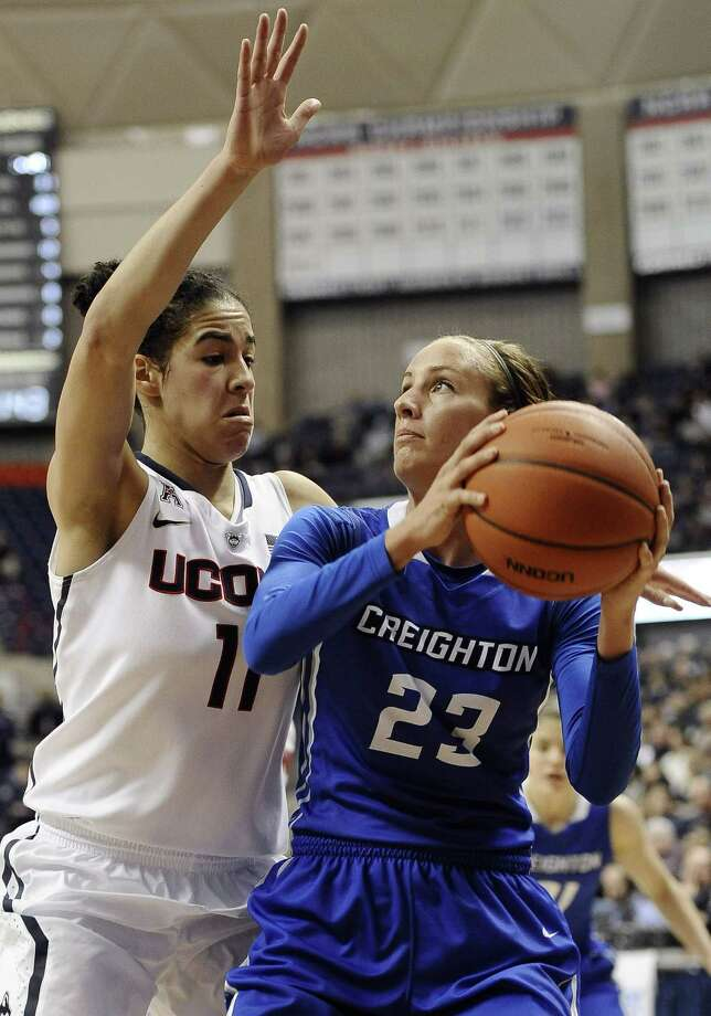 Creighton's Marissa Janning, right, looks to shoot as UConn's Kia Nurse defends during the first half of the No. 3 Huskies' 96-60 win on Sunday in Storrs. Photo: Jessica Hill — The Associated Press  / FR125654 AP