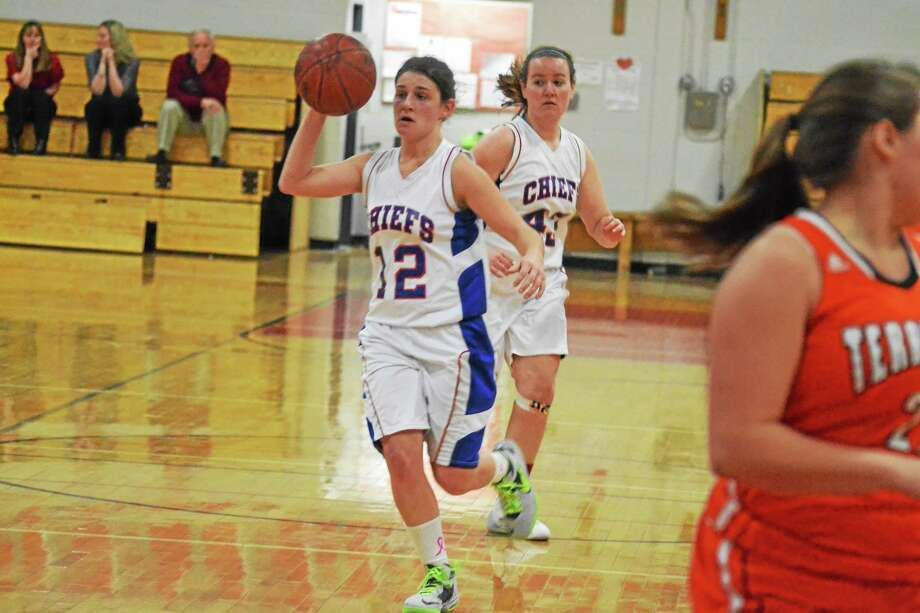 Nonnewaugís Megan Mitchell looks to make a pass in the Chiefs 42-37 win over Terryville. Photo: Pete Paguaga — Register Citizen