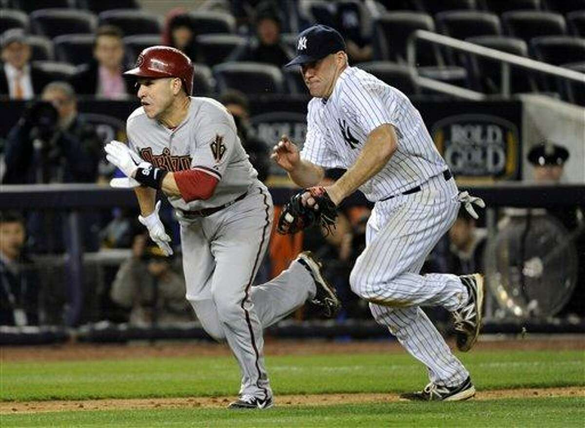 Arizona Diamondbacks' Miguel Montero, left, is tagged out by New York Yankees third baseman Kevin Youkilis during the ninth inning of a baseball game Thursday, April 18, 2013, at Yankee Stadium in New York. The Diamondbacks won 6-2 in the twelfth inning. (AP Photo/Bill Kostroun)