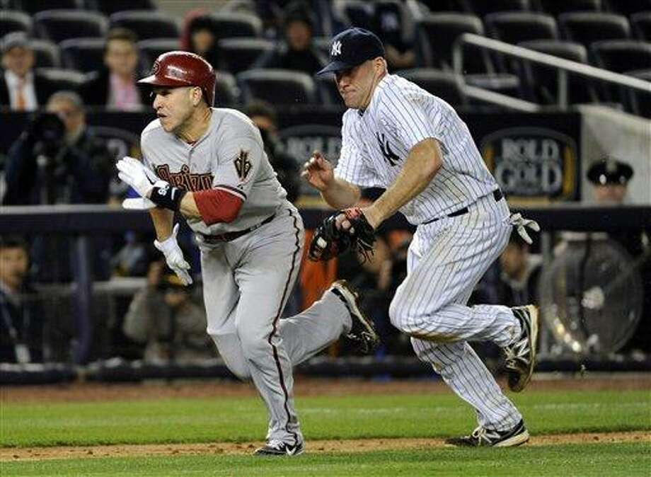 Arizona Diamondbacks' Miguel Montero, left, is tagged out by New York Yankees third baseman Kevin Youkilis during the ninth inning of a baseball game Thursday, April 18, 2013, at Yankee Stadium in New York. The Diamondbacks won 6-2 in the twelfth inning. (AP Photo/Bill Kostroun) Photo: ASSOCIATED PRESS / AP2013