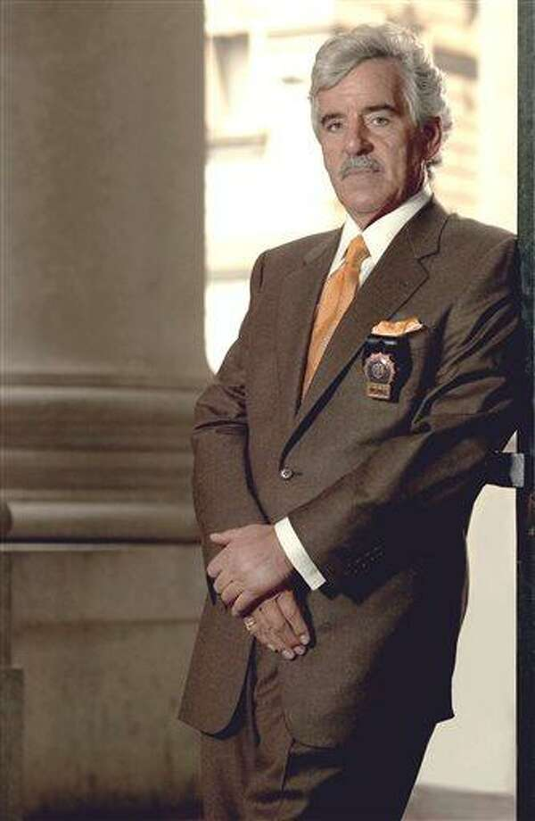 """FILE - This 2004 file image released by NBC shows actor Dennis Farina in character as Police Detective Joe Fontana on NBC's """"Law & Order.""""  Farina died suddenly on Monday, July 22, 2013, in  Scottsdale, AZriz., after suffering a blood clot in his lung. He was 69. (AP Photo/NBC, Paul Drinkwater, File) Photo: AP / NBC"""