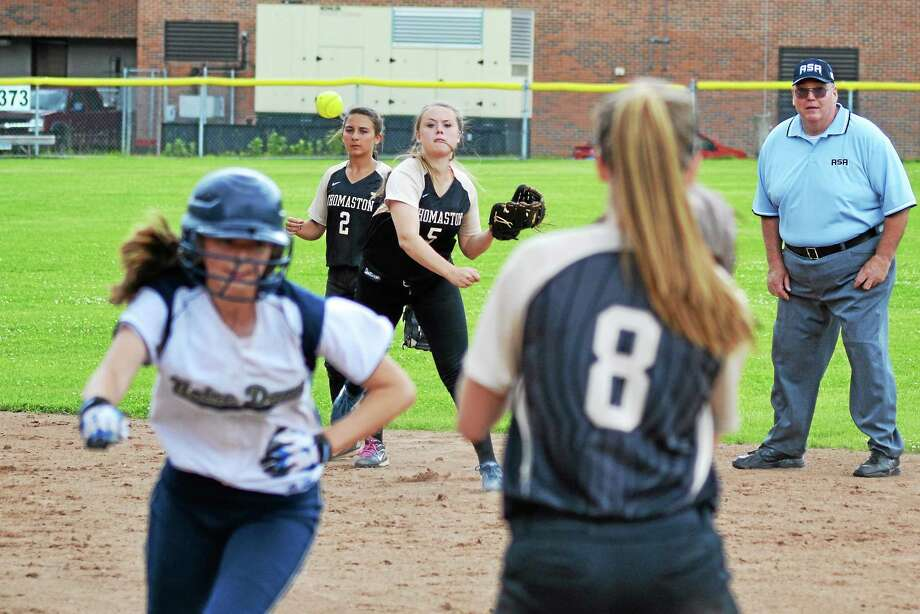 Thomaston's Abby Hurlbert, after catching a line drive, tries to double up a runner at first base. Photo: Pete Paguaga — Register Citizen