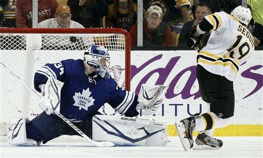 Boston Bruins' Tyler Seguin scores on Toronto Maple Leafs goalie James Reimer during the shootout in Boston's 3-2 win in an NHL hockey game in Boston on Monday, March 25, 2013. (AP Photo/Winslow Townson) Photo: ASSOCIATED PRESS / AP2013