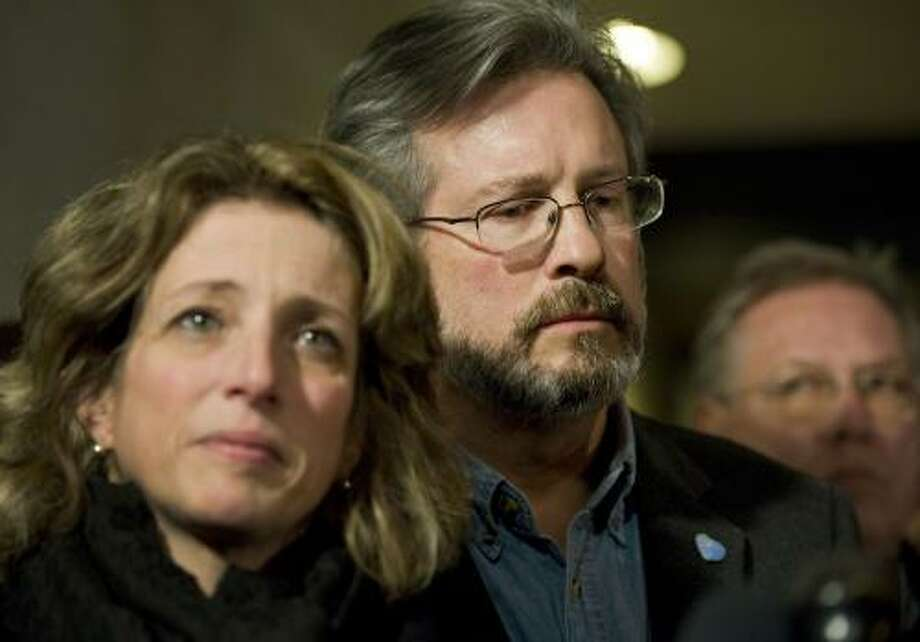 Dr. William Petit Jr., right, and his sister Johanna Chapman, left, listen to Cynthia Hawke-Wren, sister of Jennifer Hawke-Petit, as she speaks to the media outside Superior Court in New Haven after a jury condemned Joshua Komisarjevsky to death for the murder of Petit's wife and daughters in New Haven, Conn., Friday, Dec. 9, 2011.  Petit is the sole survivor of the 2007 Cheshire, Conn., home invasion where his wife, Jennifer Hawke-Petit and their daughters, Hayley and Michaela, were murdered. (AP Photo/Jessica Hill) Photo: ASSOCIATED PRESS / AP2011
