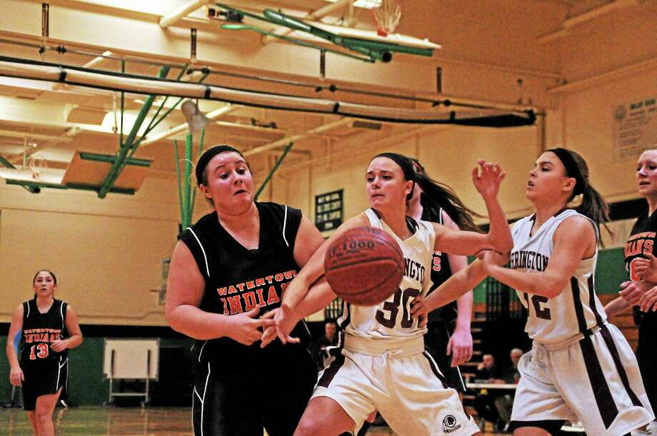 Torrington's Olivia Morrison and Taylor Howe battle for a rebound against Watertown's Sara Selimovski on Saturday. Photo: Sean Meenaghan — Register Citizen