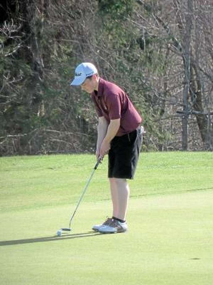 Peter Wallace/Register Citizen  Torrington High School senior co-captain Seth Thompson lines up a putt on the ninth green at Torrington Country Club Tuesday in a match against defending NVL champion Watertown.