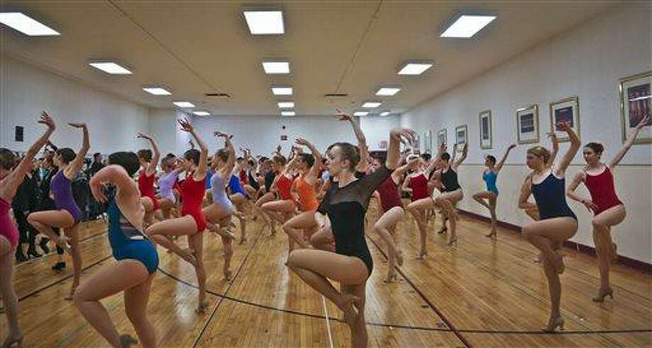 Young women from around the country audition to appear with The Rockettes at the 2013 Radio City Christmas Spectacular, Tuesday, in new York.  Those who make it will return for the show that runs from Nov. 8 to Dec. 30.  (AP Photo/Bebeto Matthews) Photo: AP / AP