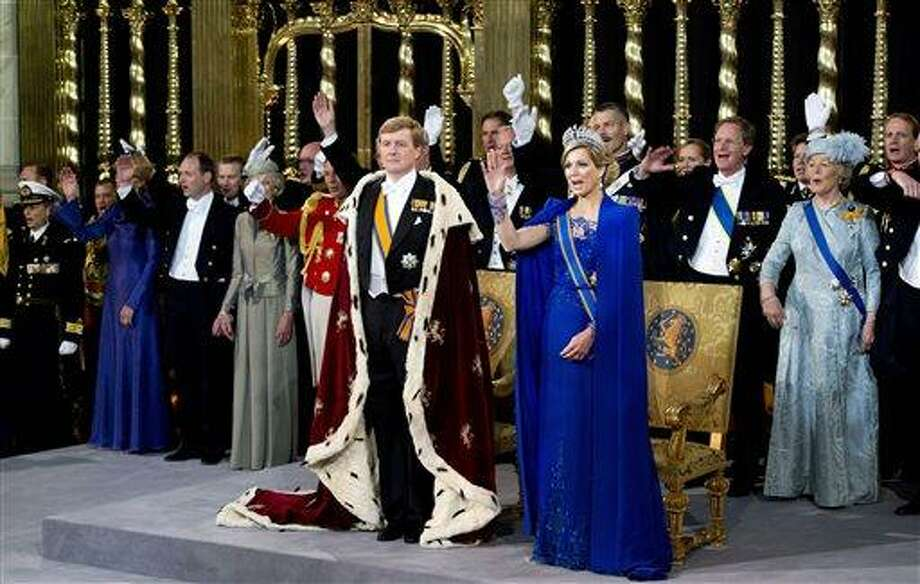 Dutch King Willem-Alexander is given three cheers by guests and his wife Queen Maxima inside the Nieuwe Kerk or New Church in Amsterdam, The Netherlands, during his inauguration Tuesday. Around a million people are expected to descend on the Dutch capital for a huge street party to celebrate the first new Dutch monarch in 33 years.  (AP Photo/Robin Utrecht, Pool) Photo: ASSOCIATED PRESS / RU2013