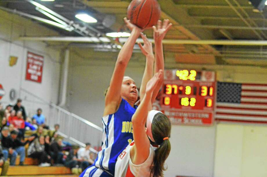 Housatonic's Lauren Segalla goes for a layup over Northwestern's Emma Beltrandi in the Mountaineers 46-44 win over the Highlanders. Photo: Pete Paguaga — Register Citizen