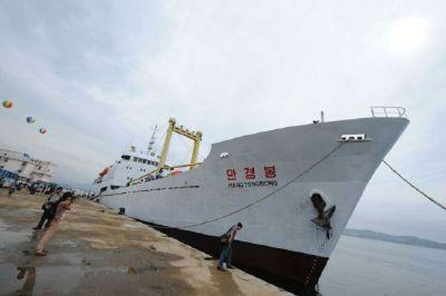 The cruise ship Mangyongbong docked at the Rason port prior to a ceremony to mark the first-ever cruise to Mount Kumgang International tourist zone, from Rason in North Korea on Aug. 30, 2011.
