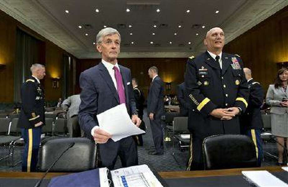 Army Secretary John McHugh, left, and Army Chief of Staff Gen. Ray Odierno, arrive on Capitol Hill in Washington, Tuesday, April 23, 2013, to testify before the Senate Armed Services Committee hearing on the Defense Department budget requests for fiscal year 2014. (AP Photo/J. Scott Applewhite) Photo: AP / AP