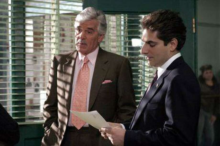 "FILE - In this undated photo from NBC Universal, Dennis Farina, who plays New York Police Detective Joe Fontana, acts in a scene with Michael Imperioli in the role of Detective Nick Falco, in an episode from NBC's police drama,""Law & Order."" Farina died suddenly on Monday, July 22, 2013, in Scottsdale, AZriz., after suffering a blood clot in his lung. He was 69. (AP Photo/ NBC Universal,Jessica Burstein) Photo: AP / NBC UNIVERSAL"