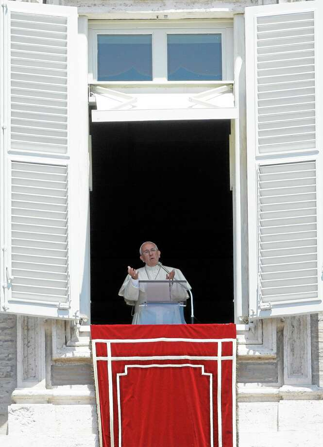 Pope Francis delivers his message during the Regina Caeli prayer from his studio overlooking St. Peter's Square at the Vatican, Sunday, June 1, 2014. (AP Photo/Gregorio Borgia) Photo: AP / AP