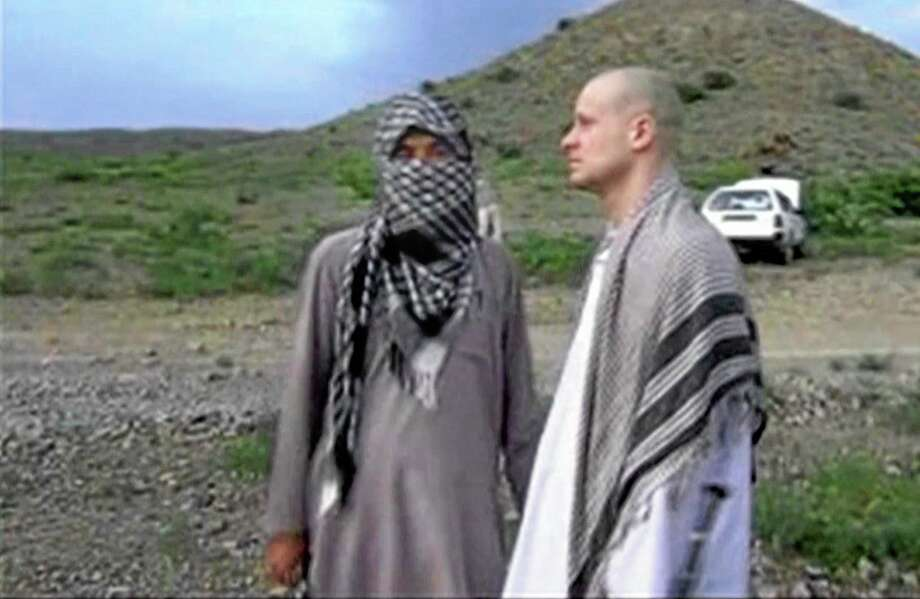 FILE - In this file image taken from video obtained from Voice Of Jihad Website, which has been authenticated based on its contents and other AP reporting, Sgt. Bowe Bergdahl, right, stands with a Taliban fighter in eastern Afghanistan. The Taliban said Friday, June 6, 2014, that Bergdahl was treated well during the five years they held him captive and was even allowed to play soccer with the men holding him. (AP Photo/Voice Of Jihad Website via AP video, File) Photo: AP / Voice Of Jihad Website