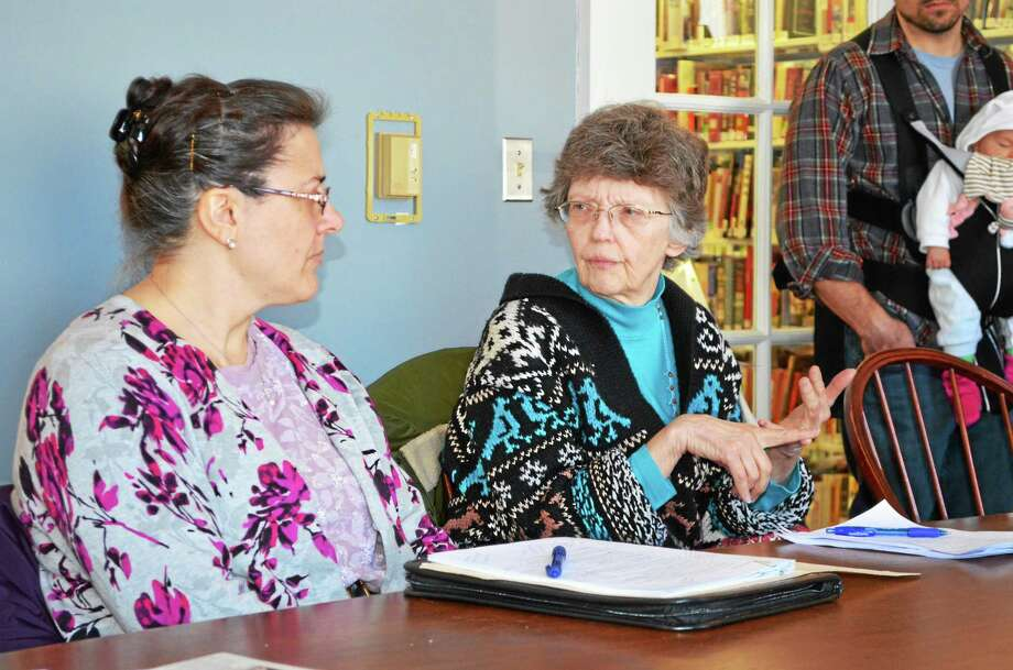Kate Hartman - Register Citizen. Town Clerk Donna LaPlante and Assistant Town Clerk Debbie Ventri answered questions at the Focus New Hartford meeting. Photo: Journal Register Co.