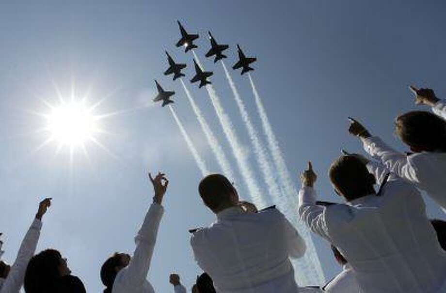 In a Tuesday, May 29, 2012 file photo, a formation of U.S. Navy Blue Angel fighter jets perform a flyover above graduating Midshipmen during the United States Naval Academy graduation and commissioning ceremonies in Annapolis, Md. (AP Photo/Patrick Semansky, File) Photo: ASSOCIATED PRESS / A2012
