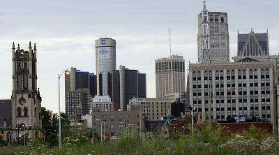 Downtown Detroit, including the General Motors World Headquarters (2nd L), is pictured from a vacant lot along Woodward Avenue in Detroit, Michigan in this July 21, 2013, file photo. Photo: REUTERS / X00064