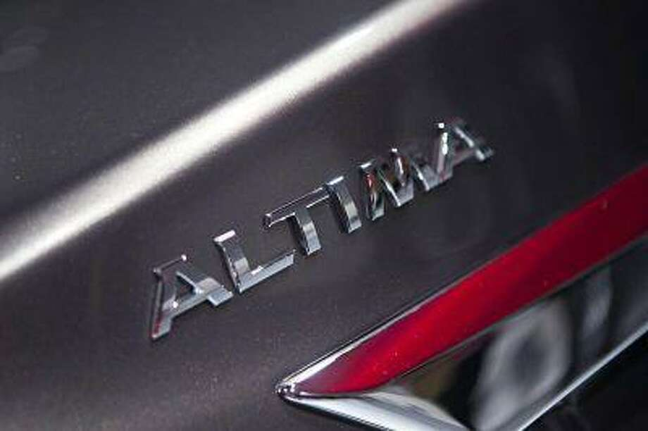 A detail of the new Nissan Altima is seen at the car's unveiling during the 2012 New York International Auto Show at the Javits Center. / X02815
