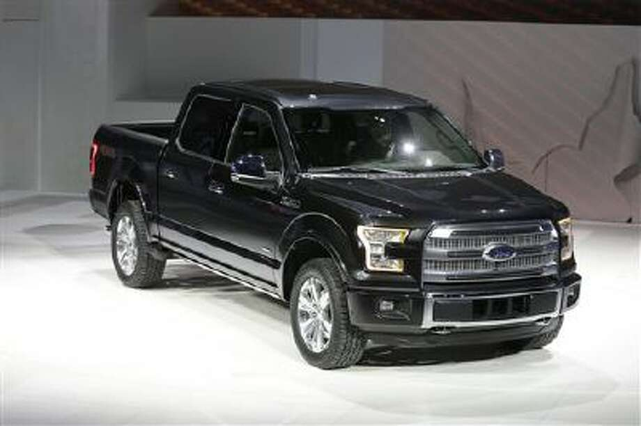 Ford unveils the new F-150 with a body built almost entirely out of aluminum. at the North American International Auto Show in Detroit, Jan. 13. Photo: AP / AP