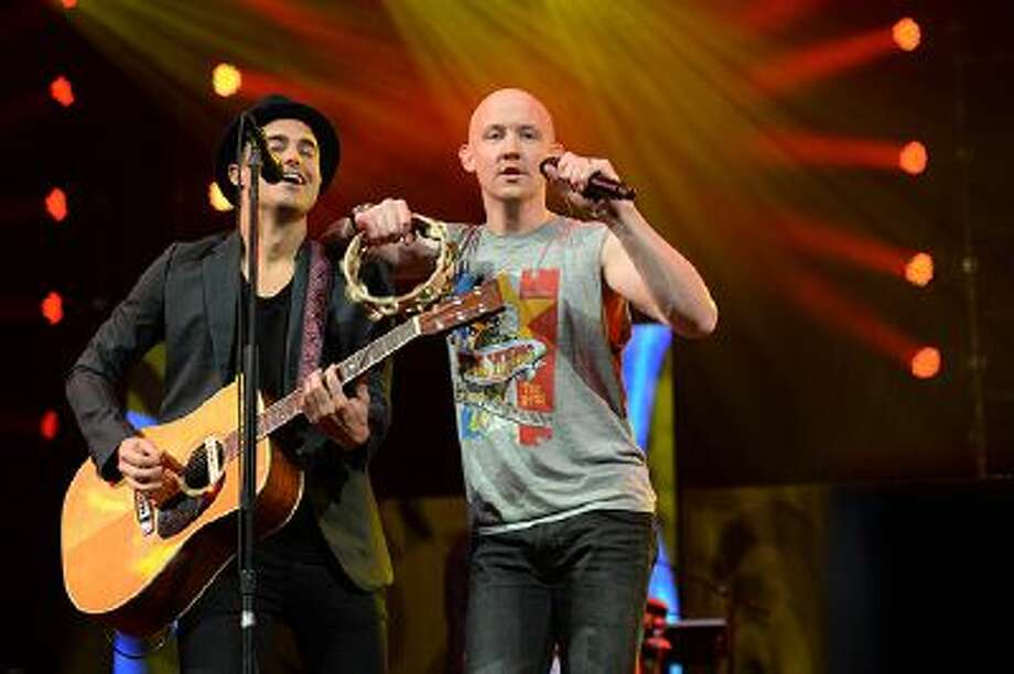 """Joe King (L) and Isaac Slade (R) of The Fray performs during Amnesty Internationals """"Bringing Human Rights Home"""" concert February 5, 2014 at the Barclays Center in the Brooklyn borough of New York. AFP PHOTO/Don EMMERT        (Photo credit should read DON EMMERT/AFP/Getty Images) Photo: AFP/Getty Images / 2014 AFP"""