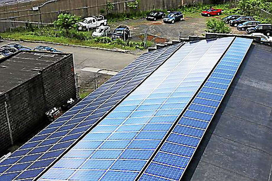 Solar panel installation on top of Crest Mechanical Services in Hartford. Photo: (Christine Stuart—CTnewsjunkie.com)