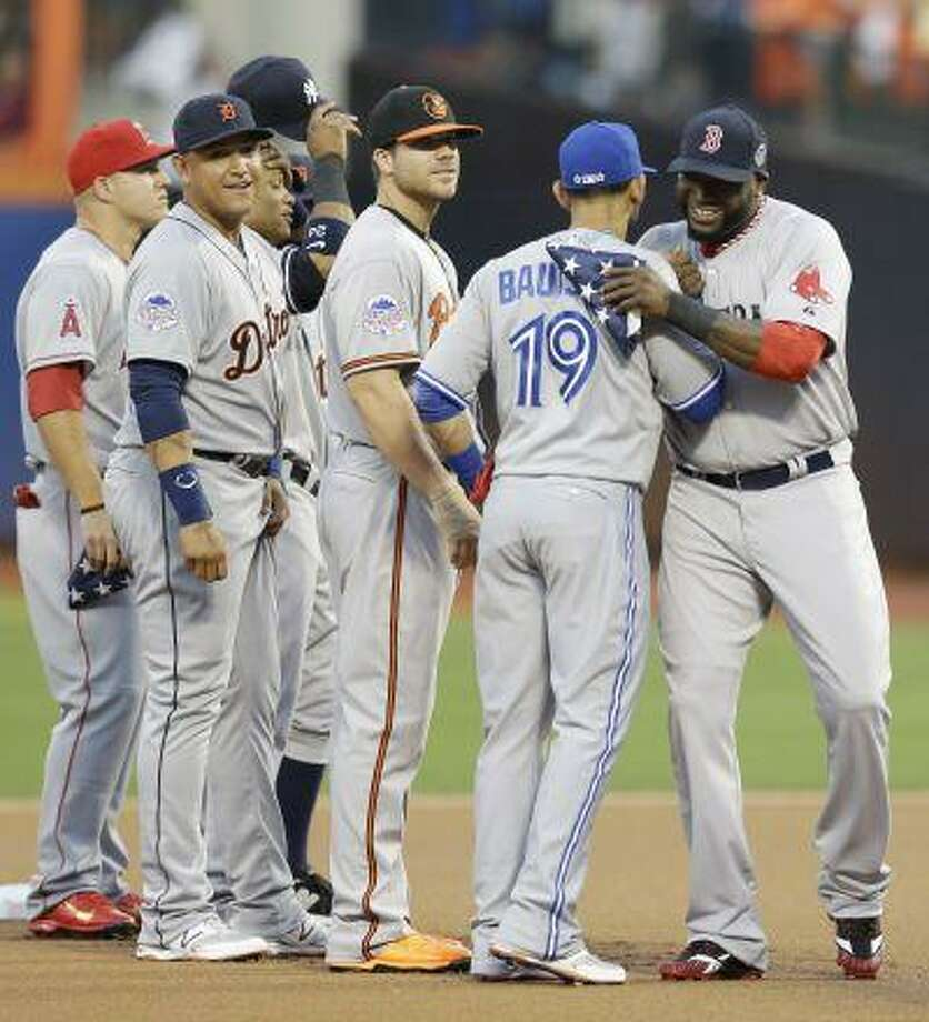 American League's David Ortiz, right, of the Boston Red Sox, is greeted by American League's Jose Bautista, of the Toronto Blue Jays, during introductions for the MLB All-Star baseball game, on Tuesday, July 16, 2013, in New York. Photo: ASSOCIATED PRESS / AP2013