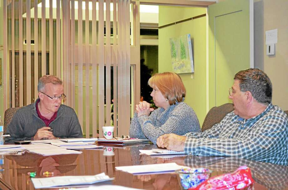 First Selectman Dan Jerram and selectmen Alesia Kennerson and Jack Casey voted to add the revised school security plan to the town meeting scheduled for Dec. 12. Photo: Kate Hartman — Register Citizen