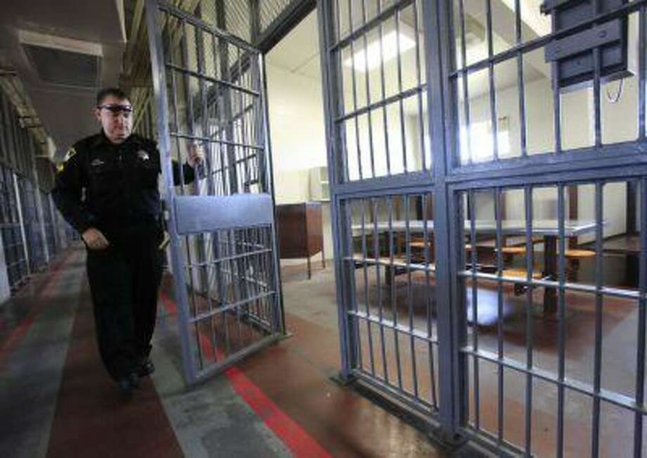 In this, Sept. 27, 2011 file photo, Sacramento County Deputy Sheriff Chris Carroll opens a cell at the Rio Cosumnes Correctional Center, in Elk Grove, Calif. Photo: AP / 2011 AP