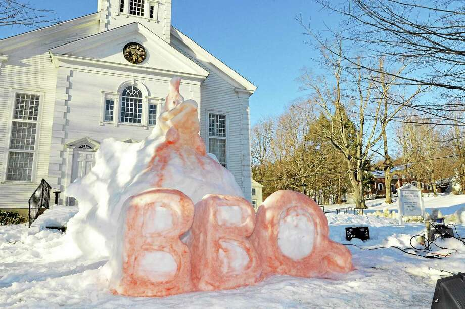 Bruce Richards created this snow sculpture in front of the Harwinton Congregational Church on Saturday to help promote the church's 42nd annual BBQ dinner. Laurie Gaboardi - The Register Citizen Photo: Journal Register Co.