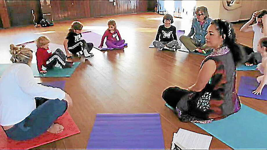 A group of young children gathered Saturday to learn yoga and gratitude in Sharon. Photo: Shako Liu-Register Citizen