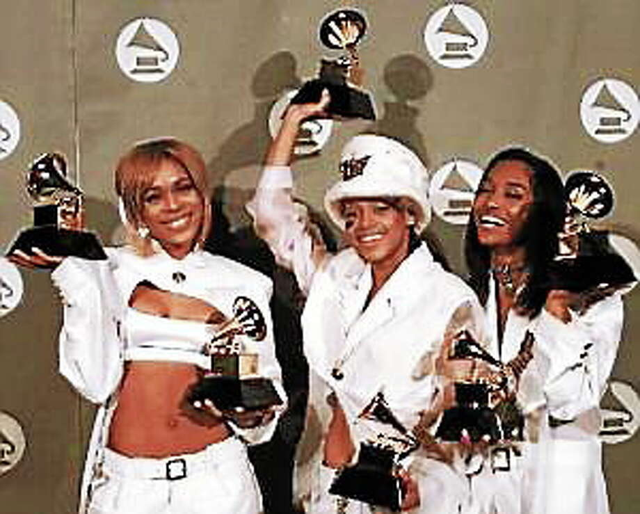 TLC - Tionne Watkins, Lisa Lopes and Rozonda Thomas - display the Grammys they received in Los Angeles on Feb. 28, 1996. Photo: (Reed Saxon — The Associated Press)