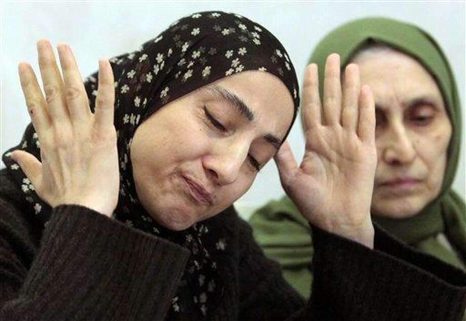 This April 25, 2013 file photo shows the mother of the two Boston bombing suspects, Zubeidat Tsarnaeva, left, speaking at a news conference in Makhachkala, the southern Russian province of Dagestan. Two government officials tell The Associated Press that U.S. intelligence agencies added the Boston bombing suspects' mother to a federal terrorism database about 18 months before the attack. At right is her sister-in-law Maryam. (AP Photo/Musa Sadulayev, File) Photo: ASSOCIATED PRESS / THE ASSOCIATED PRESS2013