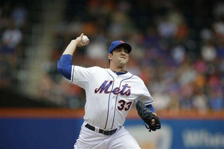 New York Mets starting pitcher Matt Harvey delivers in the first inning of a baseball game Sunday, July 21, 2013, in New York. (AP Photo/Kathy Willens) Photo: AP / AP