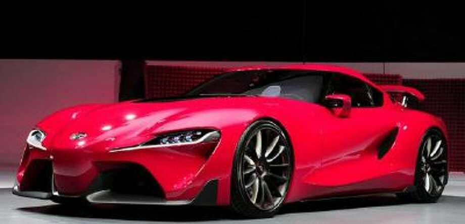 The new Toyota FT-1 Concept is revealed at the press preview of the 2014 North American International Auto Show January 13, 2014 in Detroit, Michigan.