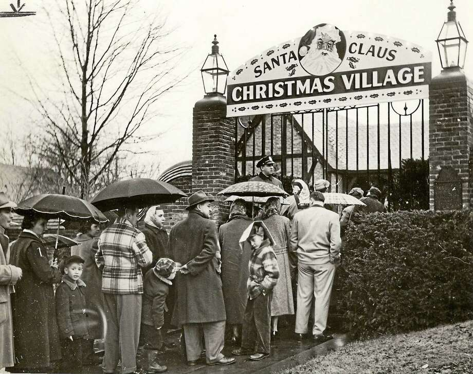 A vintage photo of the Christmas Village as people wait in line to for a visit. Photo: Contributed Photo — Collection Of The Torrington Historical Society