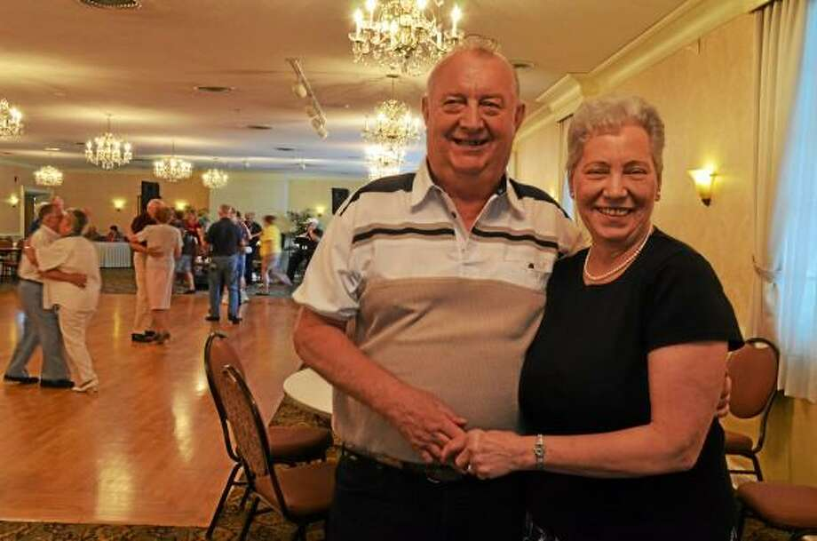 Jim Babiyan stading with his wife, Barbara at AFMA's monthly dance. Mercy Quaye -- Register Citizen