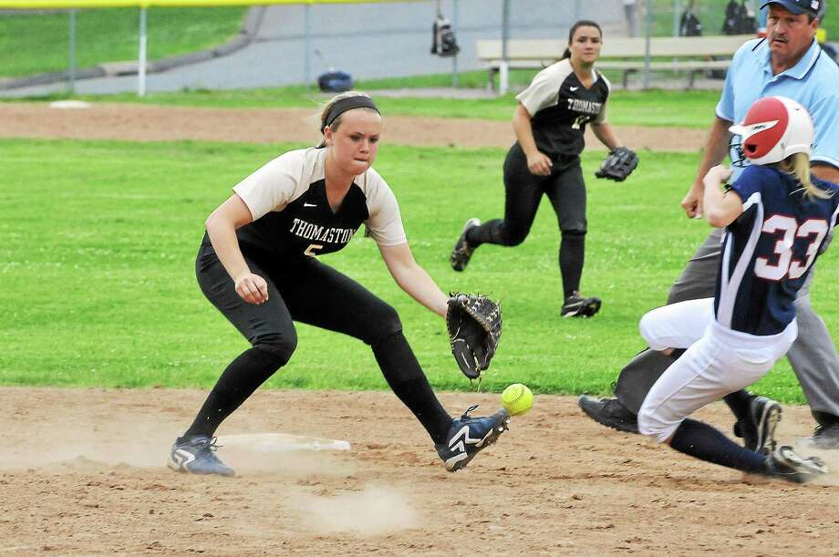 Thomaston's Abby Hurlbert looks to make a catch while St. Paul runner Emily Sklenka slides into second base. The Golden Bears won 2-1 in 10 innings. Photo: Laurie Gaboardi — Register Citizen