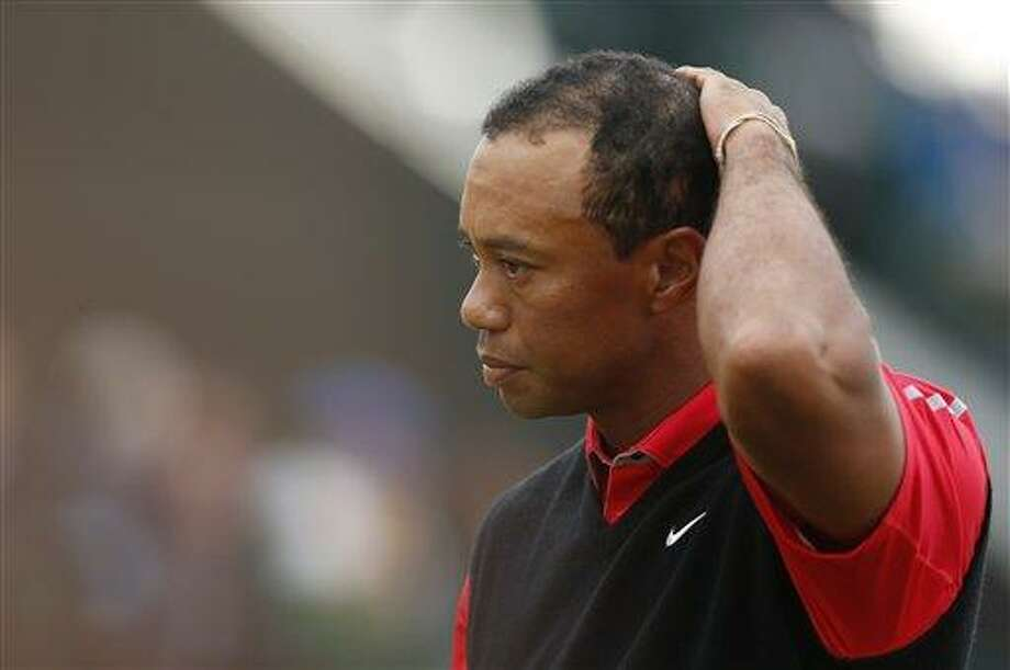Tiger Woods of the United States reacts on the 18th green at the end of the final round of the British Open Golf Championship at Muirfield, Scotland, Sunday July 21, 2013. (AP Photo/Matt Dunham) Photo: AP / AP