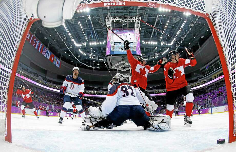 Jamie Benn scored the game's lone goal early in the second period as Canada beat goalie Jonathan Quick of Hamden and the United States 1-0 in a men's hockey semifinal game Friday at the Winter Olympics in Sochi, Russia. Photo: Julio Cortez — The Associated Press  / Pool AP