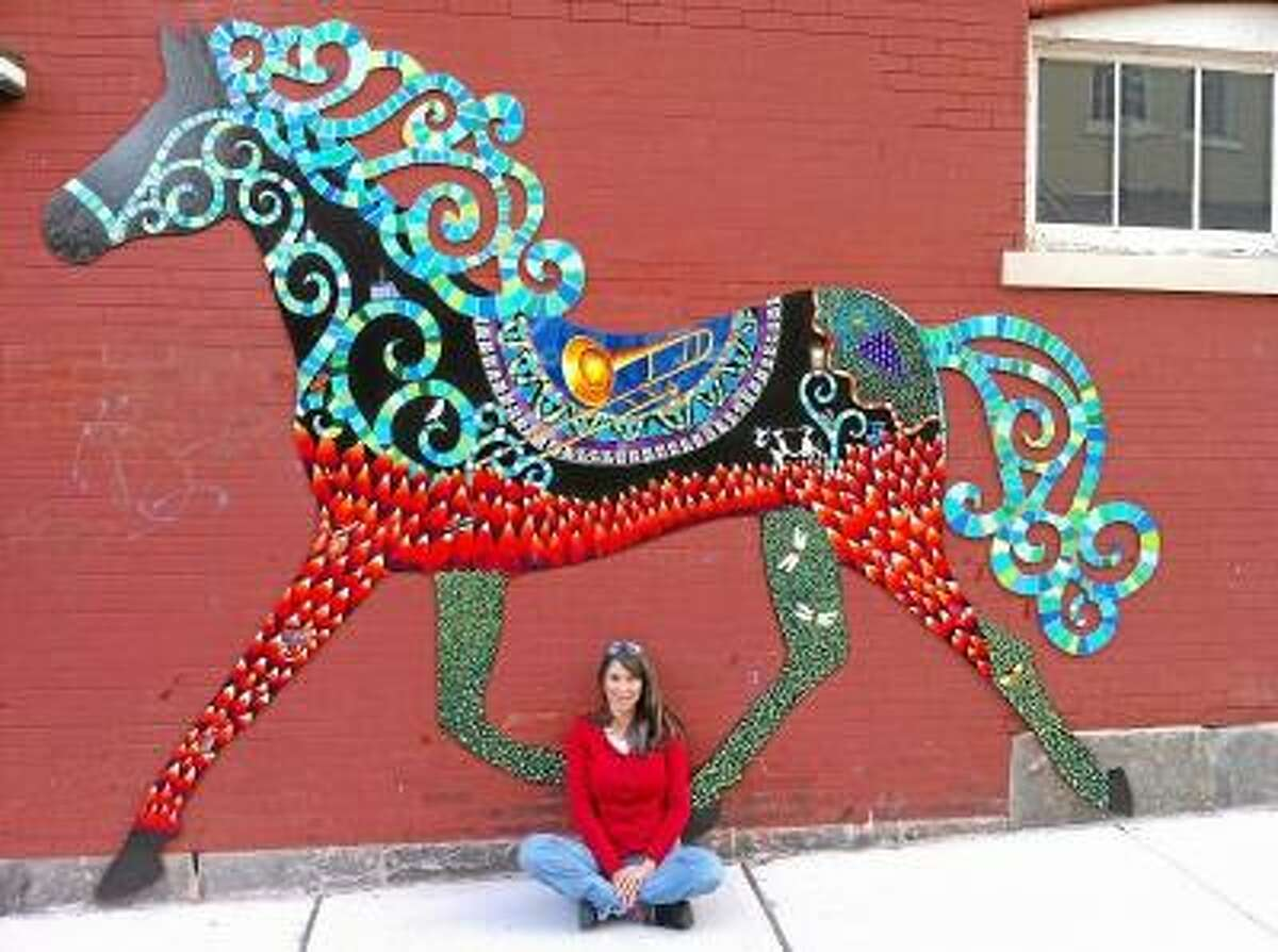 Provided photo -- Danielle Mailer with her horse artwork in downtown Torrington.