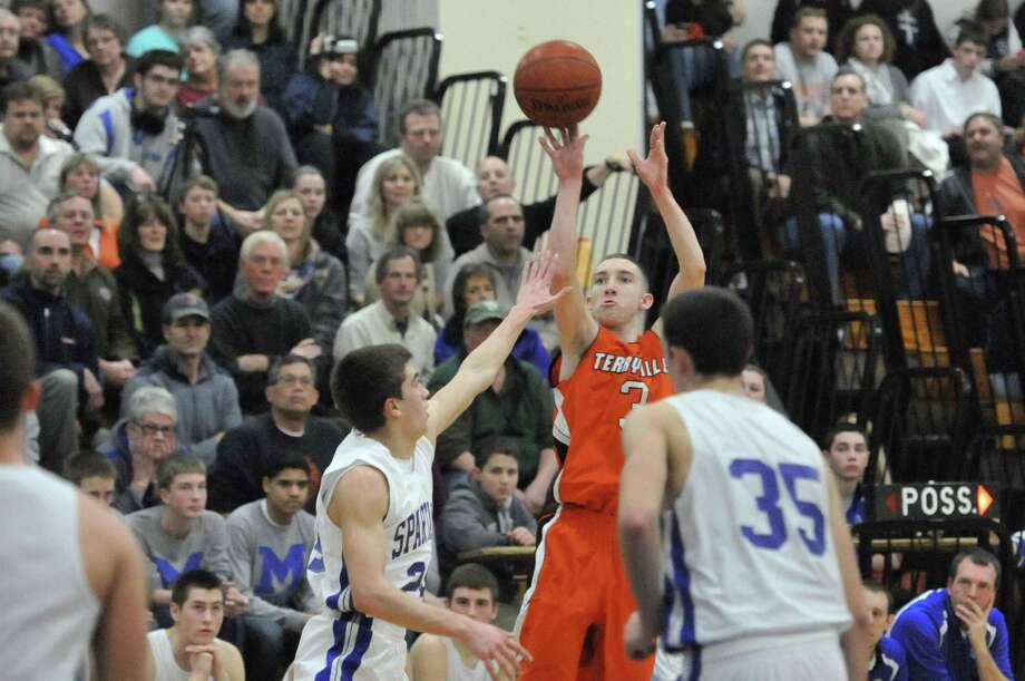 Terryville Tyler Trillo over Lewis Mills' Spencer Maloney in the Kangaroos 66-35 win over the Spartans. Photo: Laurie Gaboardi — Register Citizen