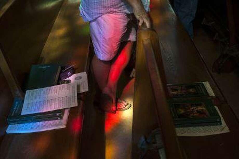 A parishioner wears shorts and flip-flops to Sunday Mass on July 14, 2013 at Our Lady of Lourdes Catholic Church in Bethesda, Md. Photo: The Washington Post / The Washington Post